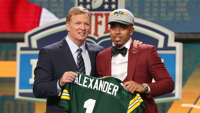 NFL commissioner Roger Goodell with Jaire Alexander as he is selected as the number eighteen overall pick to the Green Bay Packers in the first round of the 2018 NFL Draft at AT&T Stadium.