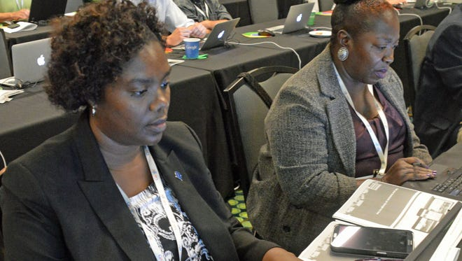 Netraya Rice, left, and her mother, Velma Rice, work at setting up a website for Netraya Rice's home-based medical-billing company, IGC Medical Billing Outsource Group LLC, during the Google Get Your Business Online workshop at Music City Center.