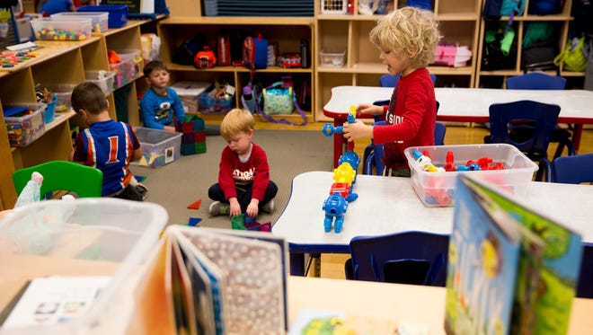 Wakefield Joyner, 5, right, plays with building blocks while his teacher Maria Abbott, not shown, works individually with students on spelling exercises at the Naples YMCA on Thursday, Jan. 4, 2018. The Early Learning Program at the YMCA has gone through many changes since Hurricane Irma destroyed several learning module trailers, forcing the YMCA to convert space and make room for its 150-plus students.