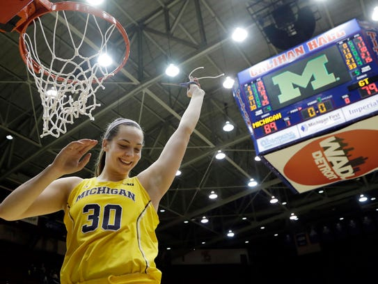 Hallie Thome cuts the net after the WNIT championship game at Calihan Hall.