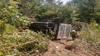 A Rockingham County sheriff's deputy suffered minor injuries after nearly being struck by a Mack dump truck that rolled down an embankment on Route 101 in Exeter Tuesday.