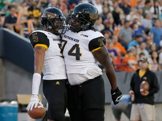 Southern Miss receiver DJ Thompson celebrates his touchdown with teammate Jerry Harris Saturday against UTEP at the Sun Bowl in El Paso, Texas.