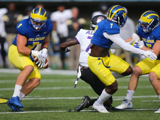 Delaware linebacker Troy Reeder hangs onto an interception early in the first  quarter against James Madison at Delaware Stadium.