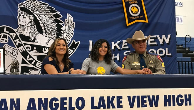 Lake View High School's Veronica Diaz celebrates signing a national letter of intent to run track for Texas A&M-Commerceon Wednesday, April 25, 2018. With her are her parents, Martha and Carlos Diaz.