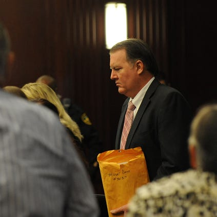 Michael Dunn enters the courtroom as his parents, Phillip and Sandra Dunn look on, before the start of his trial on Wednesday, Oct. 1, 2014 in Jacksonville, Fla.