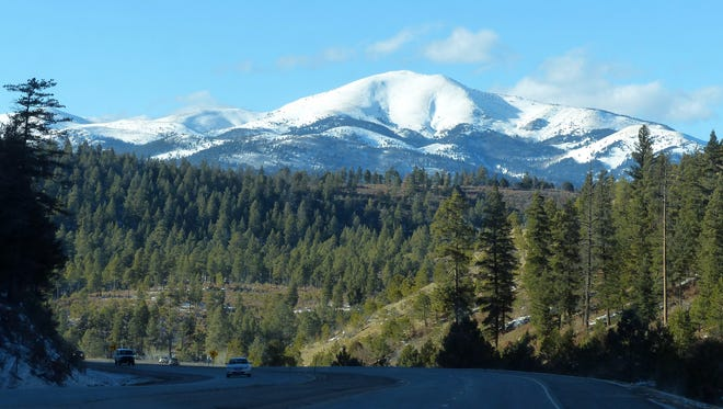 Sierra Blanca Peak and the surrounding Sacramento Mountains retained a blanket of snow after recent storms, but warmer days are taking their toll. This view is through Dark Canyon west of Ruidoso and heading back east through Mescalero.