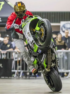 Ian Gaines went from popping opposing ball carriers at Vanderbilt to popping wheelies on his stunt motorcycle.