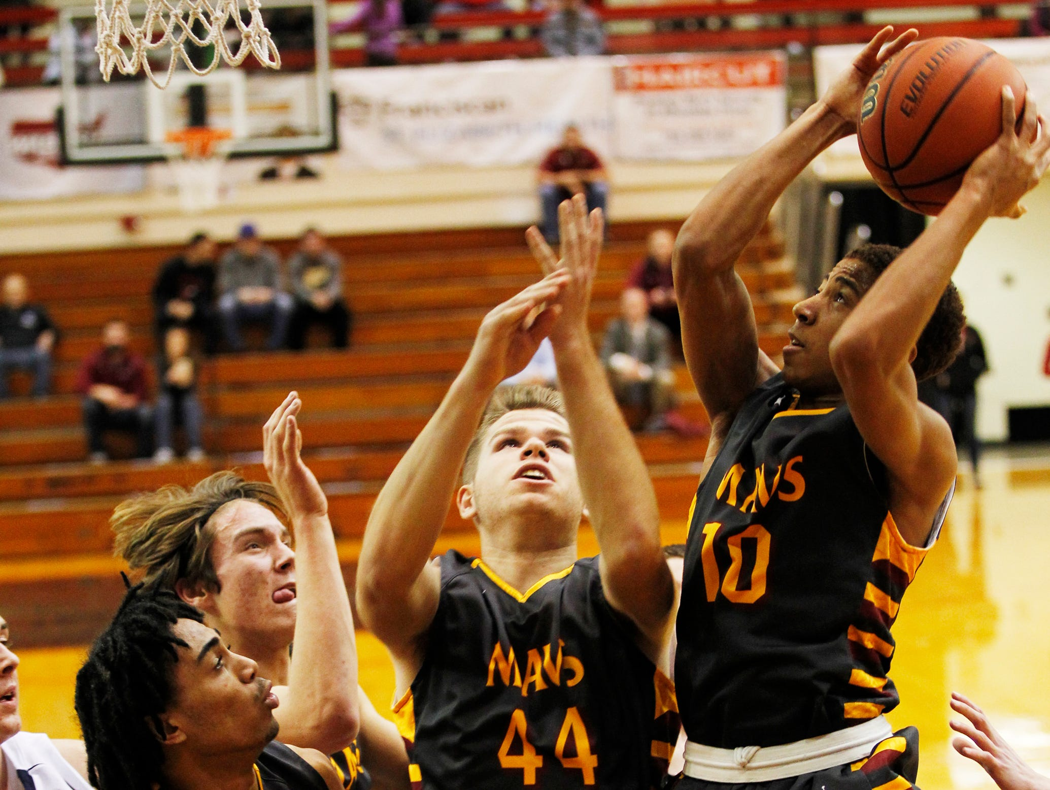 McCutcheon's Robert Phinisee pulls down a rebound in a crowd against Central Catholic in the J&C Hoops Classic Tuesday, December 1, 2015, at Lafayette Jeff. McCutcheon won in a landslide 114-44 over Central Catholic.