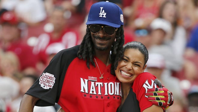 Snoop Dogg and Jordin Sparks hug before Snoop's at bat.