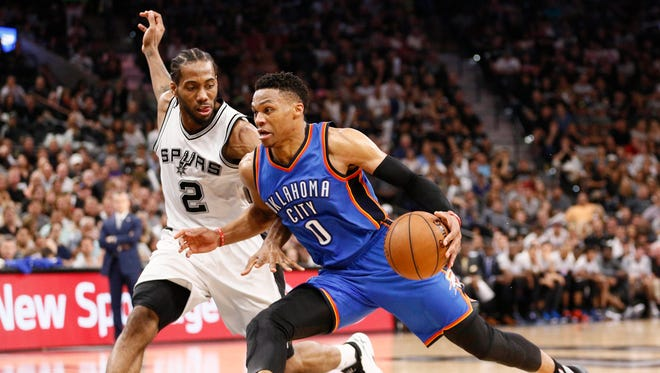 Oklahoma City Thunder point guard Russell Westbrook (0) drives to the basket as San Antonio Spurs small forward Kawhi Leonard (2) defends in Game 5.