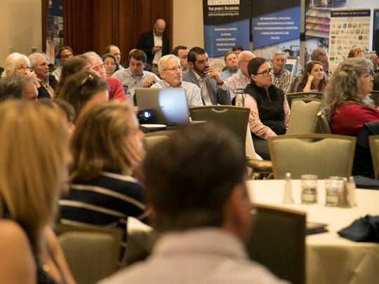 Attendees at the 27th annual Southwest Florida Water Resources Conference listen as journalist and author Michael Grunwald speaks about the Everglades in his keynote address on Friday, Feb. 2, 2018, in Fort Myers.