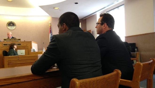 Jarred Evans, left, and his attorney Paul Laufman in Hamilton County Municipal Court today.