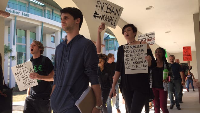 About 50 Florida Gulf Coast University students protested Friday against the administration of President Donald Trump and his immigration policies.