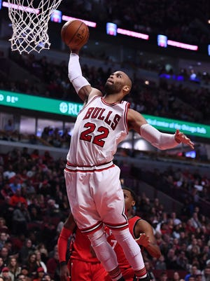 Chicago Bulls forward Taj Gibson dunks the ball against the Toronto Raptors during the first half at the United Center.