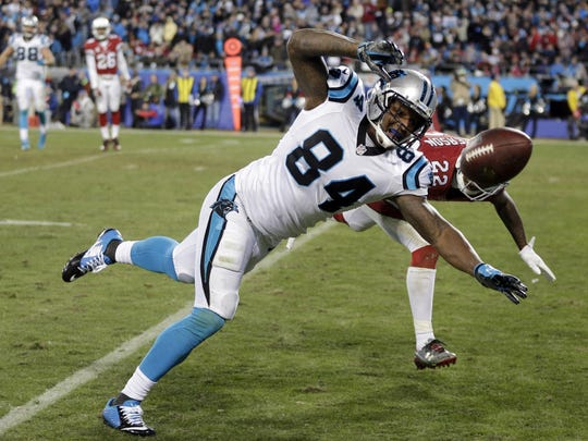 Carolina Panthers' Ed Dickson can't catch a pass in front of Arizona Cardinals' Tony Jefferson during the second half the NFL football NFC Championship game Sunday, Jan. 24, 2016, in Charlotte, N.C. (AP Photo/Chuck Burton)