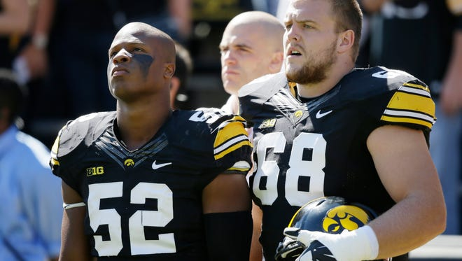 Iowa linebacker Quinton Alston, left, and offensive lineman Brandon Scherff look on during the Hawkeyes' loss to Iowa State.