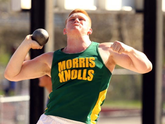 Morris Knolls senior Tom Griese competes in shot put