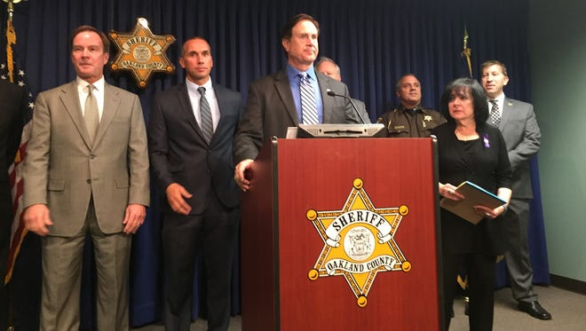 Oakland County Sheriff Michael Bouchard, surrounded by other top local law enforcement officials, speaks Monday during a press conference called to protest planned legislation that would allow prisoners  automatic parole after serving their minimum sentences in most cases.