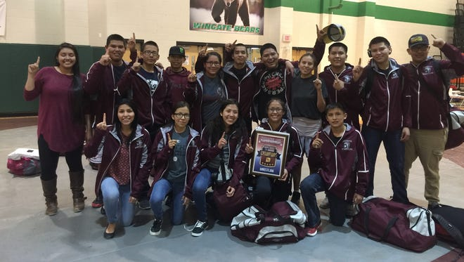 The Shiprock wrestling team poses with a championship plaque after winning the District 1-4A Duals on Friday in Wingate.