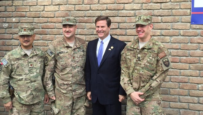 Donald Norcross, visiting with soldiers in Afghanistan in 2015, is hosting a constituent services fair Tuesday. Veterans and military agencies will be on hand.