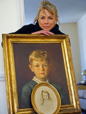 Alfred I. duPont's great-granddaughter, Susanna Dent, is shown with a painting of her father Alfred duPont Dent from 1939. The bottom painting is her grandmother Victorine duPont Dent. Susanna Dent now resides in Baltimore.