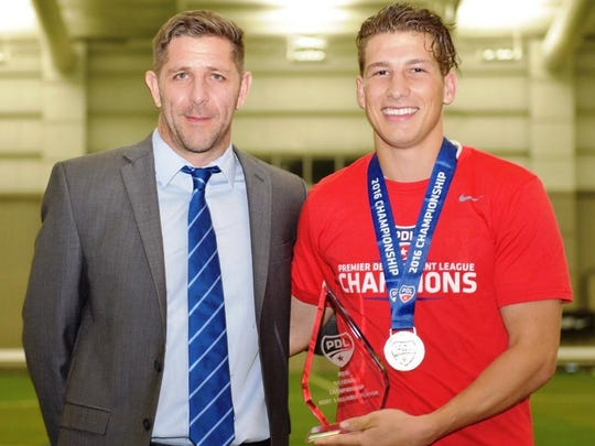 The Michigan Bucks' Russell Cicerone (right) is presented the tournament MVP award by PDL Director of Operations Todd Eason.