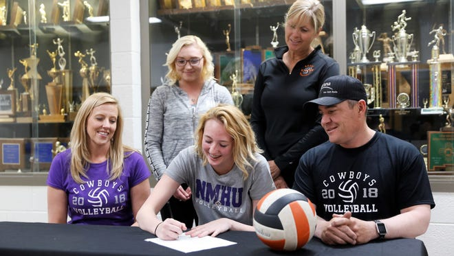 Aztec's Taley Ferrari signs her letter of intent on Wednesday to continue her volleyball career at NCAA Division II New Mexico Highlands University.