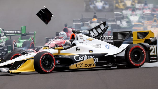CHF RacingÕs Josef Newgarden (21) is hit and turned sideways  as the field of cars turns into turn one at the start of the the Angie's List Grand Prix of Indianapolis Saturday, May 9, afternoon at the Indianapolis Motor Speedway.