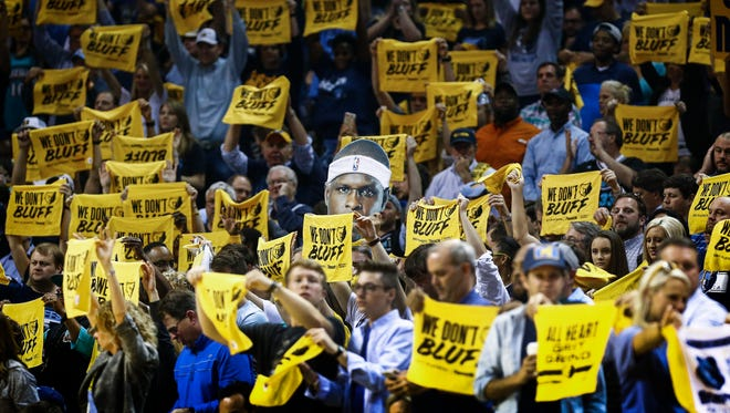Memphis Grizzlies fans cheer during fourth quarter action against the San Antonio Spurs at the FedExForum.