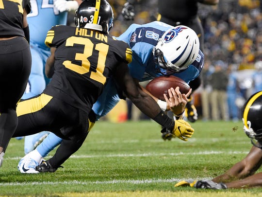 Titans quarterback Marcus Mariota (8) dives into the end zone for a touchdown in the first quarter at Heinz Field Thursday, Nov. 16, 2017 in Pittsburgh, Pa.