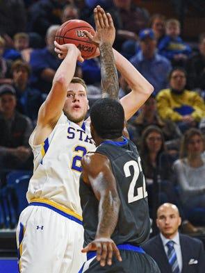 SDSU's Mike Daum (24) takes a shot over Fort Wayne's
