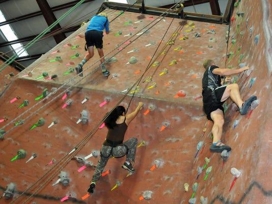 TRY THIS Indoor rock climbing