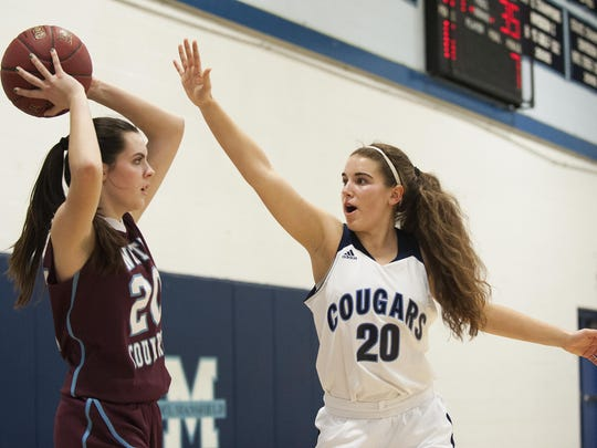 MMU's Devyn Beliveau-Gale (20) tries to block a pass during a high school girls basketball game last season.