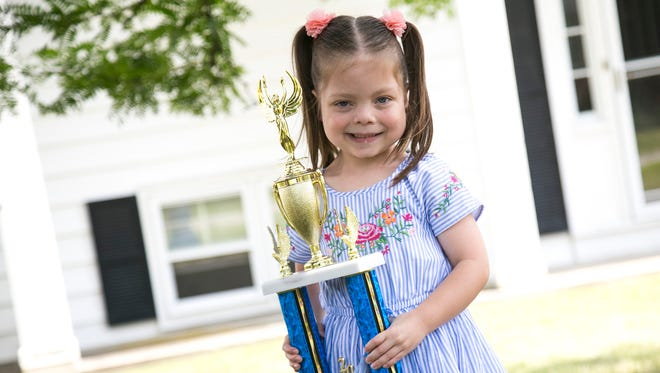"""Elliana Nelson, 6, won Ontario Youth Sports' """"Can You Picture Ontario"""" photo contest this year. Her mother, Samantha, took the photo of Elliana eating an ice cream cone."""