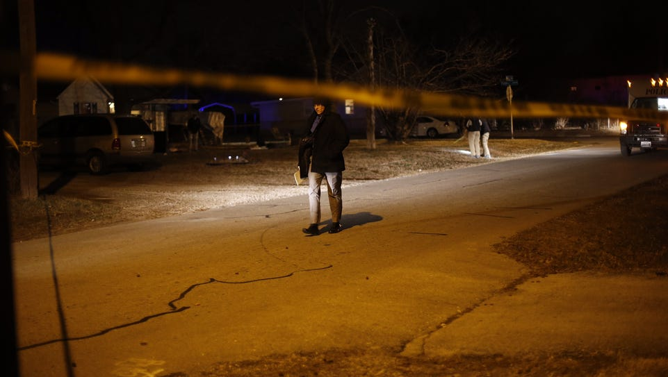 Police work at the scene of a fatal shooting Saturday