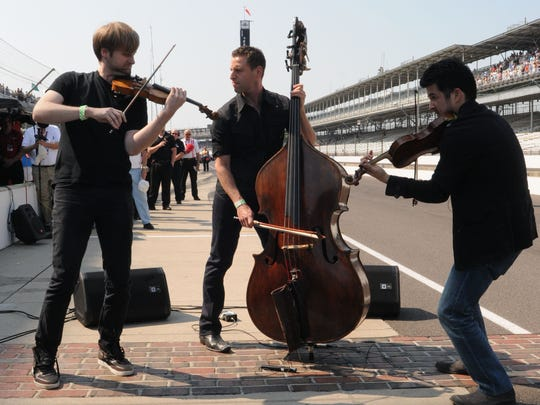 Time for Three (from left: Zach De Pue, Ranaan Meyer and Nicolas Kendall) performed the national anthem at Indianapolis Motor Speedway in 2012.