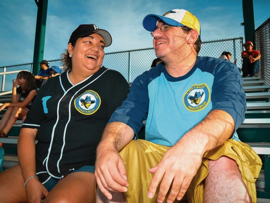 Heather Wagner, left, and Eric Tellez talk baseball strategy before the start of the Las Cruces Vaqueros home opener at Apodaca Park last weekend. Wagner and Tellez have been fans since the start of the Vaqueros in 2010, attending the very first home game.