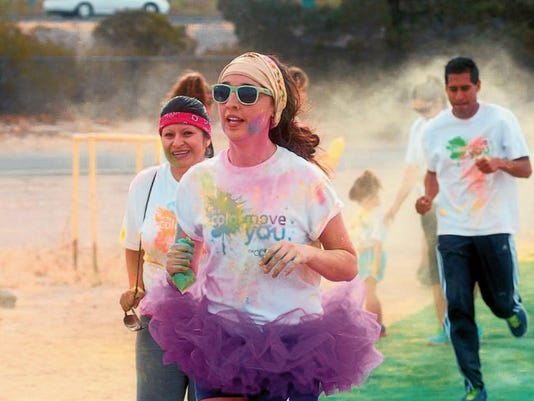 Participants run in the 2014 CAAtch Me if You Can Color Dash 5K.