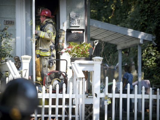 Lebanon firefighters handle a fire at 722 N. Ninth St., Lebanon, Thursday afternoon. The fire started in the oven. Fire Commissioner Duane Trautman estimated damage to the house at 20,000 to 25,000.