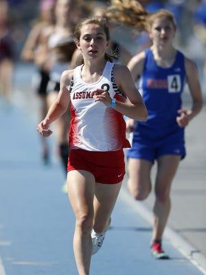 Davenport Assumption's Julia Schumacher won the Class 3-A 3,000 in her favorite white uniform.