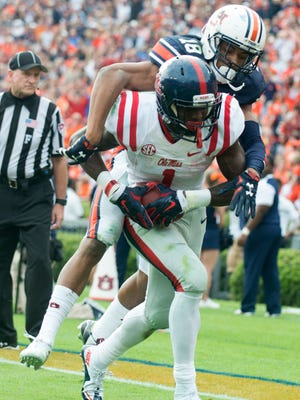 Ole Miss wide receiver Laquon Treadwell  scores a touchdown over Auburn Tigers defensive back Carlton Davis (18) during the fourth quarter of the NCAA football game between Auburn and Ole Miss on Saturday, Oct. 31, 2015, at Jordan-Hare Stadium in Auburn, Ala.