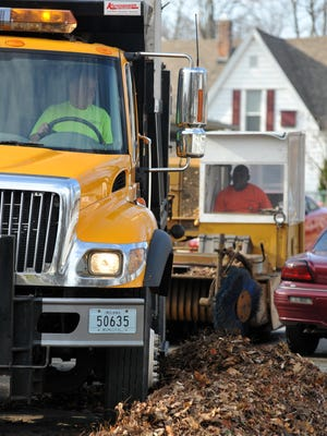 Richmond Street Department workers collect leaves from city streets.