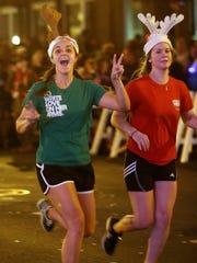 Two runners race to the finish line in the 2012 Jingle Bell run in downtown Tallahassee.