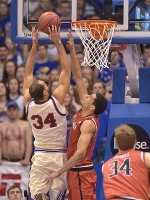 Kansas Jayhawks forward Perry Ellis takes it to the basket.