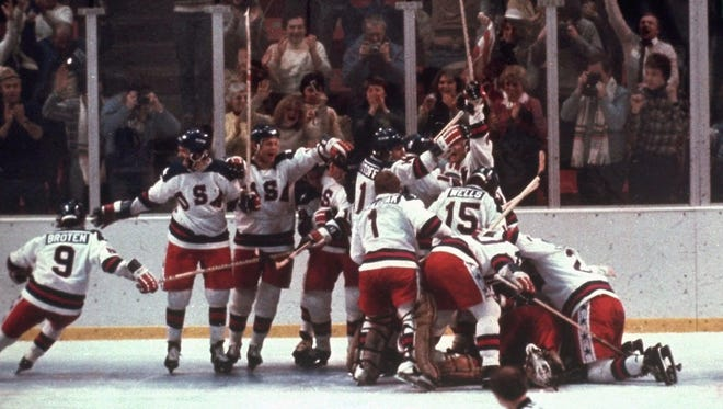 "The U.S. hockey team pounces on goalie Jim Craig after the 4-3 ""Miracle on Ice"" victory against the Soviet Union in the 1980 Olympics on Feb. 22 in Lake Placid."