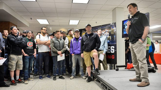 St. Cloud State head wrestling coach Steve Costanzo talks about their NCAA Division II championship Tuesday during a program to honor the team at Atwood Memorial Center.