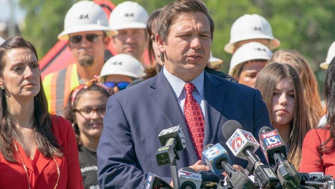 SARASOTA -- Gov. Ron DeSantis speaks during a press conference in May; after which he signed a bill authorizing three new toll roads in Florida.