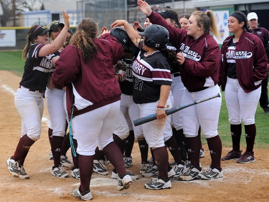 The McMurry softball team congratulates Kayla Otis