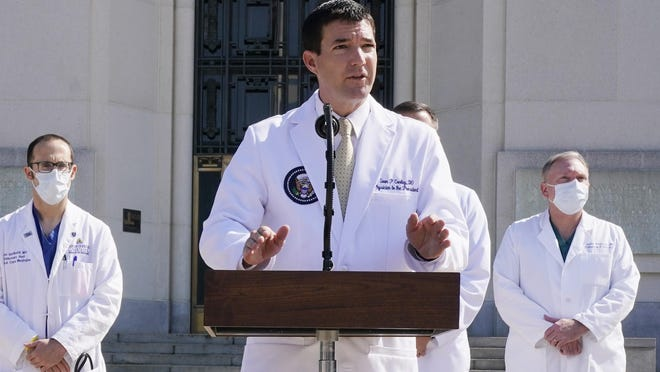 Dr. Sean Conley, physician to President Donald Trump, briefs reporters at Walter Reed National Military Medical Center in Bethesda, Md., Sunday, Oct. 4, 2020. Trump was admitted to the hospital after contracting the coronavirus.