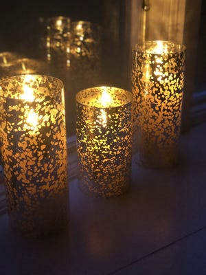 These candles burned to honor three Somerset Berkley Regional High School students who died in March. The school announced that a sophomore had died on Monday, and asked that the school community place candles in their windows once again, to show their support for the family.
